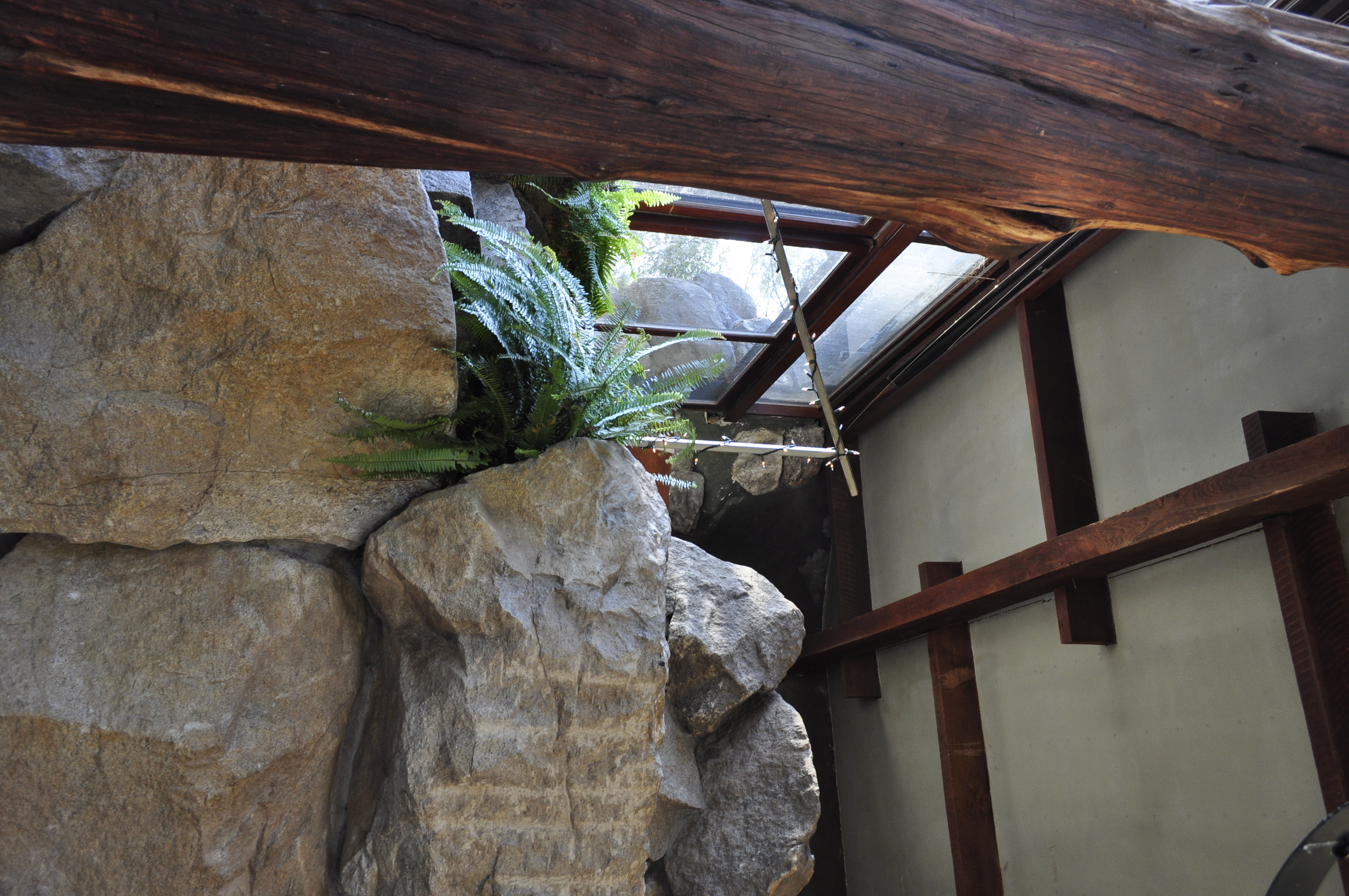 More boulders and wooden planks in the sitting area.